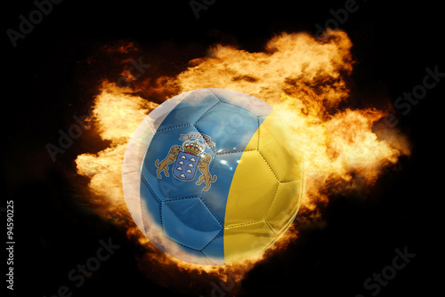 Tuinposter Canarische Eilanden football ball with the flag of canary islands on fire