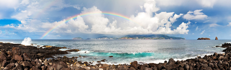 Beautiful panoramic summer seascape at the Azores with a beautiful rainbow and cloudscape