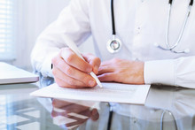 Medical Diagnose, Hands Of Doctor Writing In Clinical Record