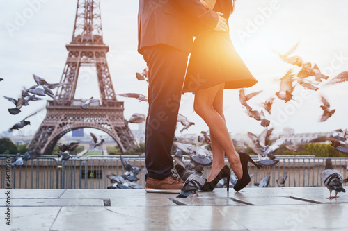 Tuinposter Parijs couple near Eiffel tower in Paris, romantic kiss