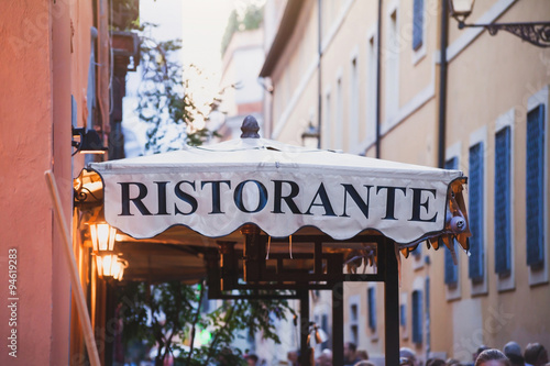 italian restaurant, sign on the street in Rome, Italy - 94619283