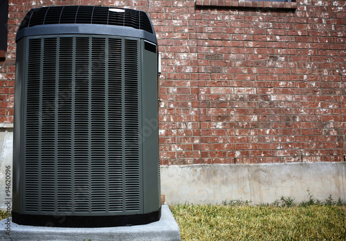 Photo High efficiency modern AC-heater unit, energy save solution in front of brick wa
