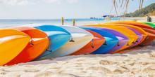 Row Of Colorful Kayaks At Sea ...