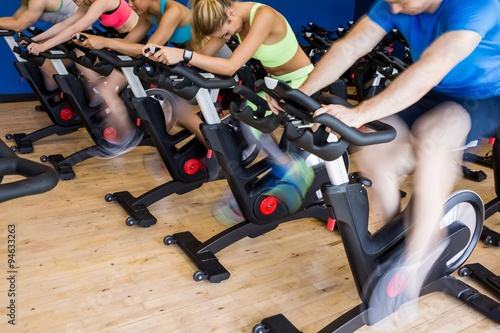 Fit people in a spin class Fototapeta