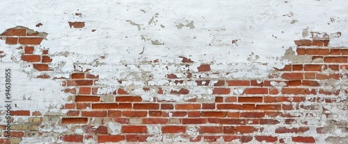 Foto op Plexiglas Wand Texture Of Old Whitewashed Grungy Brick Wall With Peeling Plaste