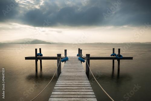 Fototapety, obrazy: Wooden pier on the lake. Fog. Long exposure.