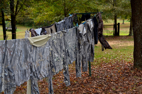 Fotobehang Jacht Washed and airing hunting clothes on the clothesline. Preparing scent free clothes.