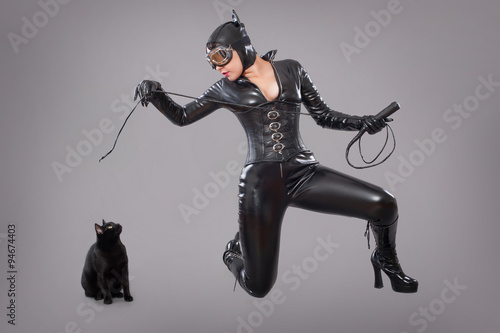 Fotografie, Obraz  catwoman / Beautiful woman in catwoman leather latex whith whip