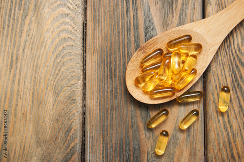 Valokuva  fish oil capsules in a spoon