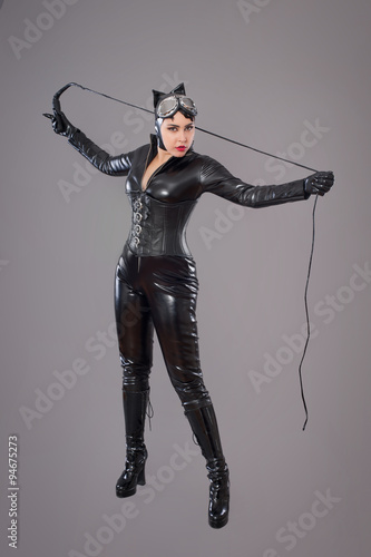 catwoman / Beautiful woman in catwoman leather latex whith whip Fotobehang