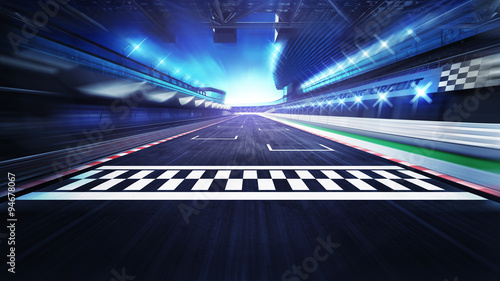 Photo Stands Motor sports finish line on the racetrack with spotlights in motion blur