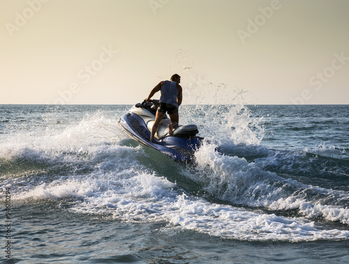 Poster Water Motor sporten Silhouette of man on jetski at sea