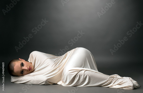 Photo  Wrapped girl with resigned expression on her face