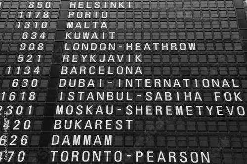 Poster Aeroport flights information board in airport terminal