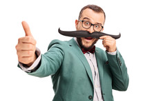 Man With Fake Moustache Giving A Thumb Up