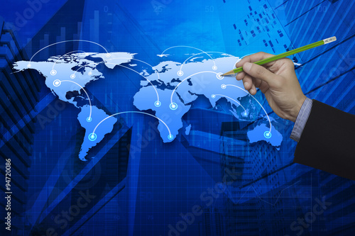 Businessman hand holding a pencil pointing at global connection #94720086