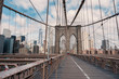 Brooklyn Bridge in New York City with cloudy blue sky at day time.