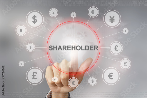 Fotografía  business hand pushing shareholder button