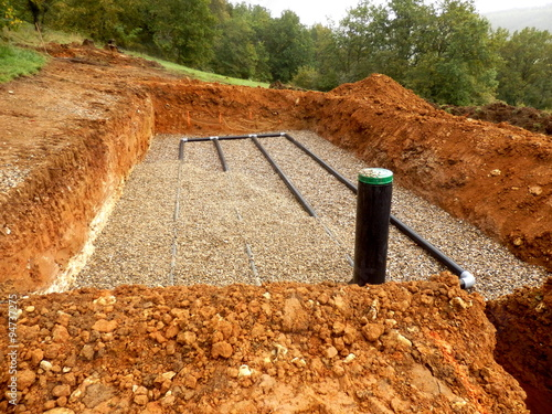 Photo  Bottom layer of pipework laid on gravel in the construction of a sand and gravel