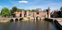 Medieval Fortress City Wall Gate Koppelpoort And Eem River In The City Of Amersfoort, Netherlands