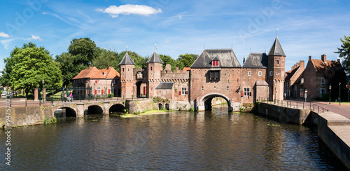Medieval fortress city wall gate Koppelpoort and Eem River in the city of Amersf Canvas Print