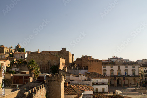 The path over the walls of Cáceres. View of the old quarter of the city with the town hall in the right. Spain