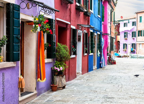 street with multi-colored bright houses on Burano's island, Venice, Italy - 94782089