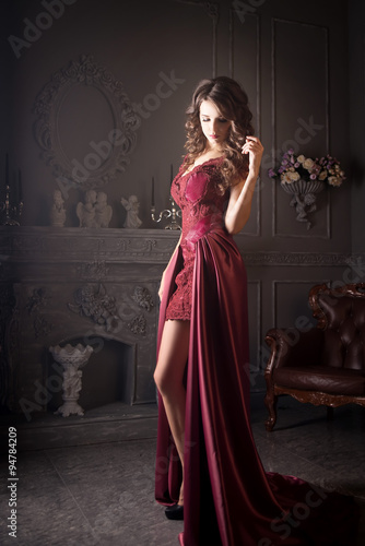 Fotografie, Obraz  Attractive woman in long claret lace dress