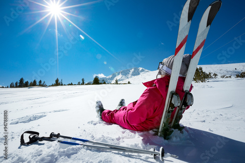 Fotografering Skier relaxing at sunny day on winter season