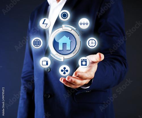 Fototapeta Business, technology and internet concept - businessman holding virtual icons obraz na płótnie
