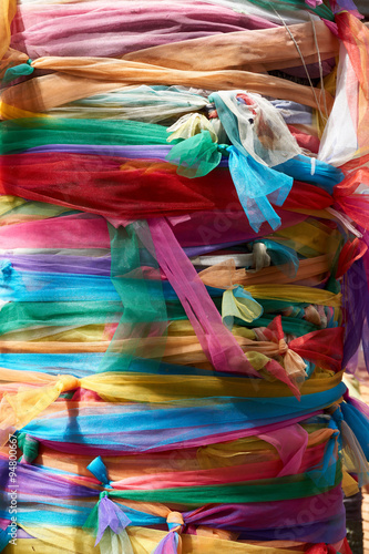 Fotobehang Paradijsvogel bloem Colorful fabric wrap the tree with faith