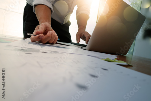 Fotografía  Double exposure of businessman hand working with new modern comp