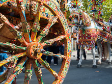 Close Up View Of A Colorful Wheel Of A Typical Sicilian Cart During A Folkloristic Show