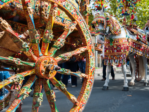 Fotografie, Obraz  Close up view of a colorful wheel of a typical sicilian cart during a folklorist
