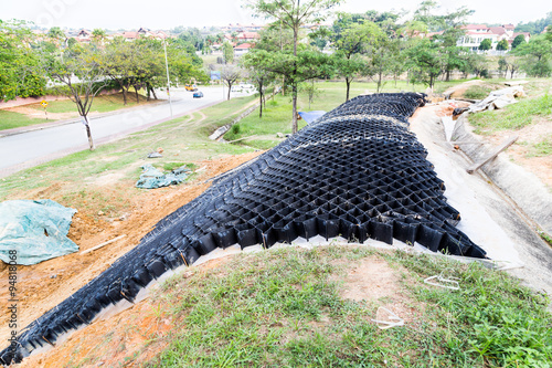 Tablou Canvas Slope erosion control with grids and earth on steep slope