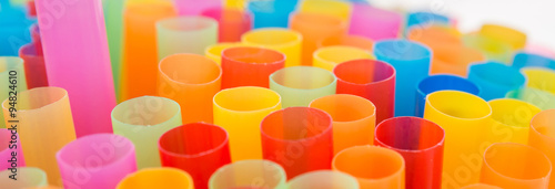 Photo  Closeup of Colorful drinking straws background.