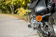 Motorcycle Saddlebag And Turn Signal In Focus. Nature Background.