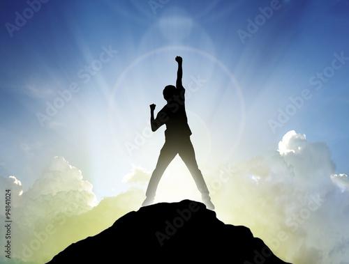 Fotografiet  Man on the peak of mountain and suntlight  , success,winner conc