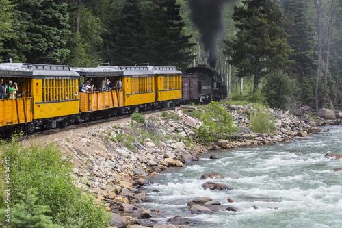 The Durango and Silverton Narrow Gauge Railroad Steam Engine travels along Animas River, Colorado, USA, 07.08.2014