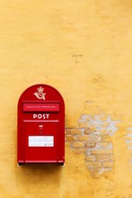 Red Danish Letterbox On A Yellow Wall