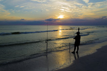 Fisherman At Sunset On Tropical Beach