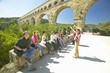 canvas print picture - Tourists at the Pont du Gard, Nimes, France