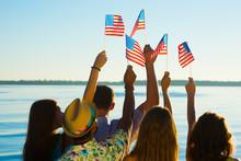 People Waved American Flags.