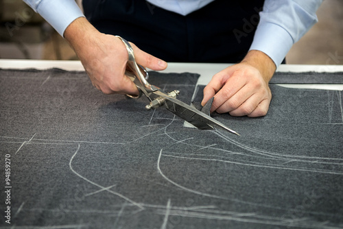 Tailor cutting fabric