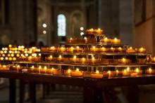 Candles Burning Inside Basilica Of The Sacred Heart Of Jesus, Paris, France