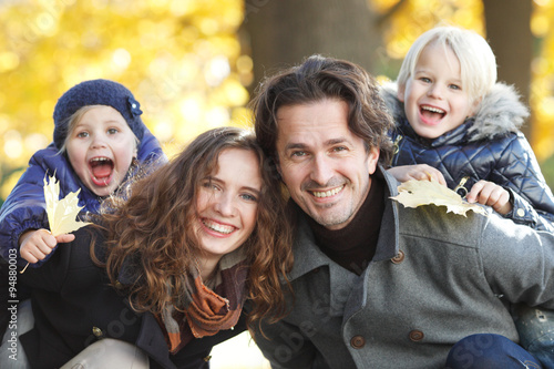 Juliste  Happy family in autumn park