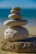 Stones balance, pebbles stack over blue sea in Croatia.