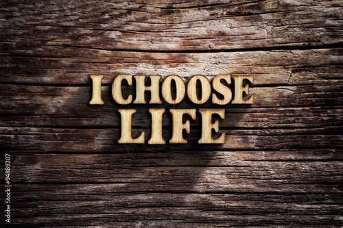 I choose Life. Words on old wooden board. Poster