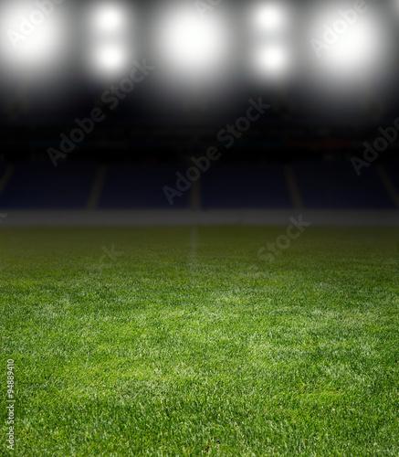 Fotografiet  stadium under the bright focuses