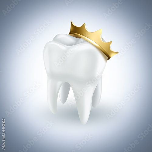 Valokuva  tooth with gold crown